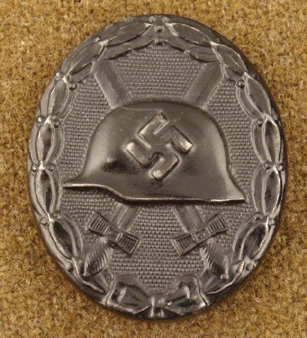 WWII Nazi Black Wound Badge Pin Back w/ Helmet Swastika