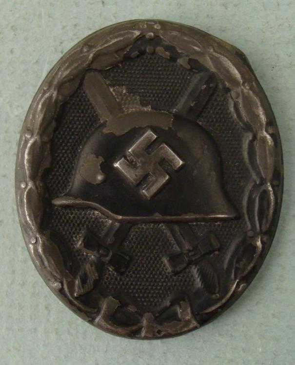 ORIG NAZI BLACK WOUND BADGE- W/HELMET, SWASTIKA, SWORDS