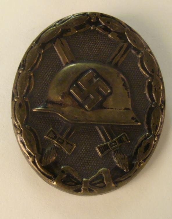 BLACK NAZI WOUND BADGE-HELMET/SWASTIKA CROSSED SWORDS