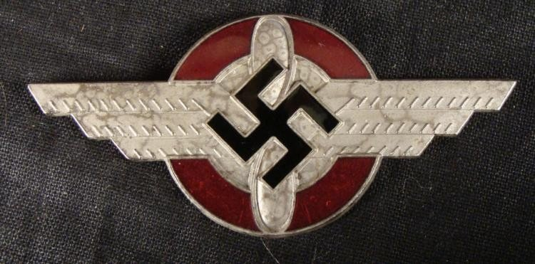 NAZI DLV BADGE WITH AN ENAMEL BACKGROUND AND SWASTIKA