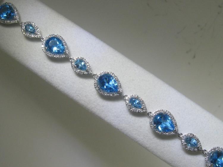 Blue Topaz and .57 ct Diamonds 14K White Gold Bracelet