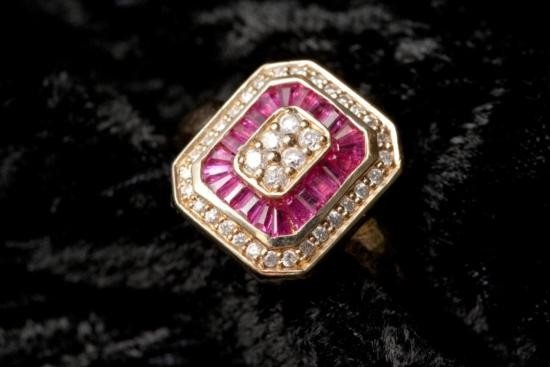 14KT yellow gold ladies ruby and diamond ring.