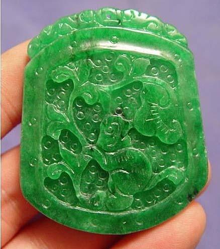 Handcarved Green Jade Pendant depicting a monkey
