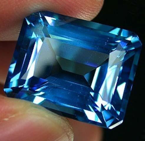 Beautifully cut 36.47 ct. Natural Emerald Cut Swiss Blu