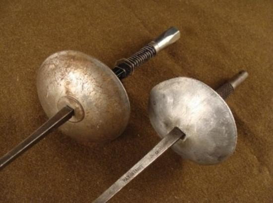 TWO (2) FRENCH MADE VINTAGE FENCING FOILS/SWORDS