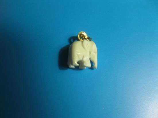 Hand Carved Ivory Elephant Pendant with gold vermil