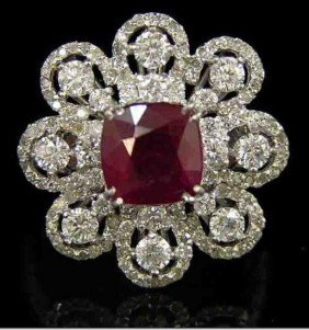 An 14K White Gold Floriform Burmuse Ruby and Diamond Ri