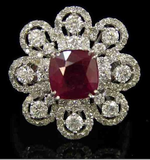 An 14K White Gold Floriform Burmuse Ruby and Diamond Ri