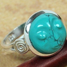 HANDCARVED TURQUOISE FACE SET IN STERLING SILVER RING
