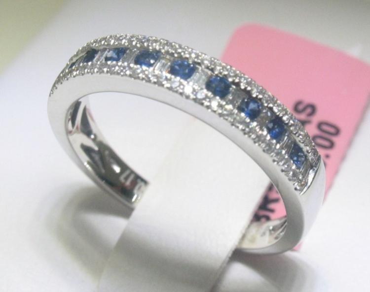 .14 CT Blue Sapphire and .25 CT Diamonds 14K WG Ring
