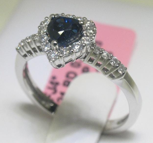 1.05 CT Blue Sapphire and .40 CT Diamonds 18K WG Ring