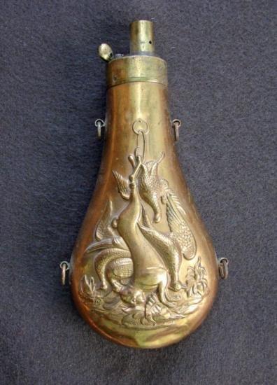 Powder Flask depicting Captured Game Scene