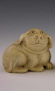 Signed Carved Ivory Netukes early 20th c of a dog