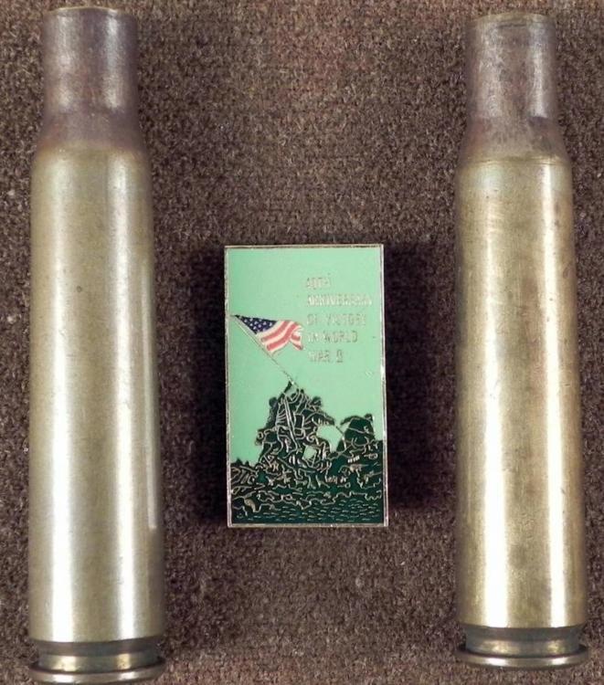 2) ORIGINAL 1943 BRASS ARTILLERY SHELLS AND BADGE