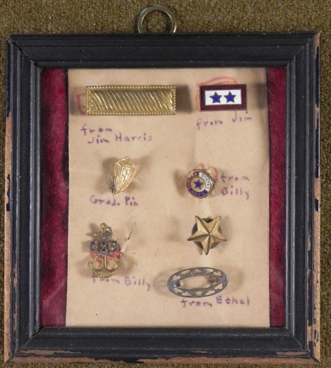 6 WWII INSIGNIAS IN FRAME FROM EACH FAMILY MEMBER