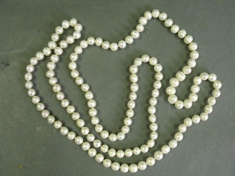 A long pearl necklace 48 in
