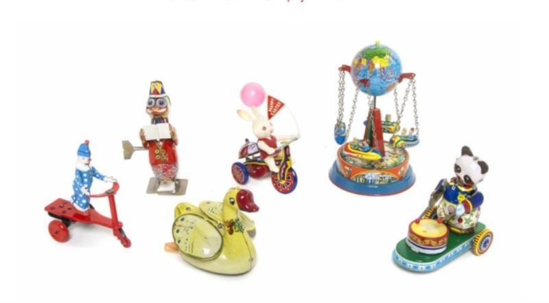 Five Pressed Tin Mechanical Toys comprising a duc