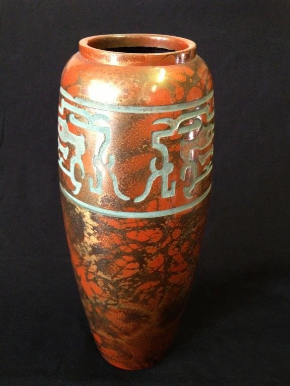 An oriental bronze vase with a marbled patina