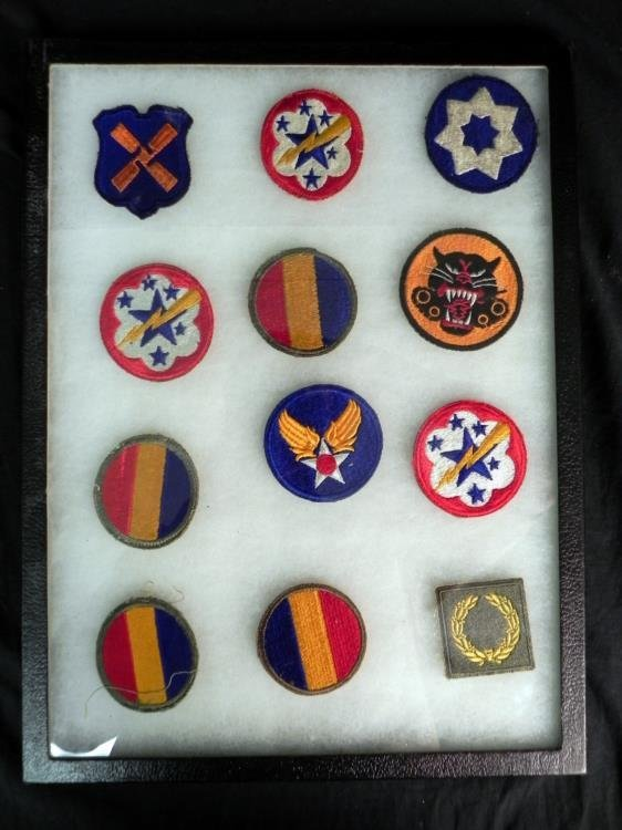 COLLECTION OF 12 WWII PATCHES IN RIKER MOUNT CASE