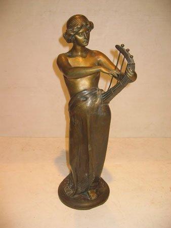 60D: Joueuse de harpe en bronze