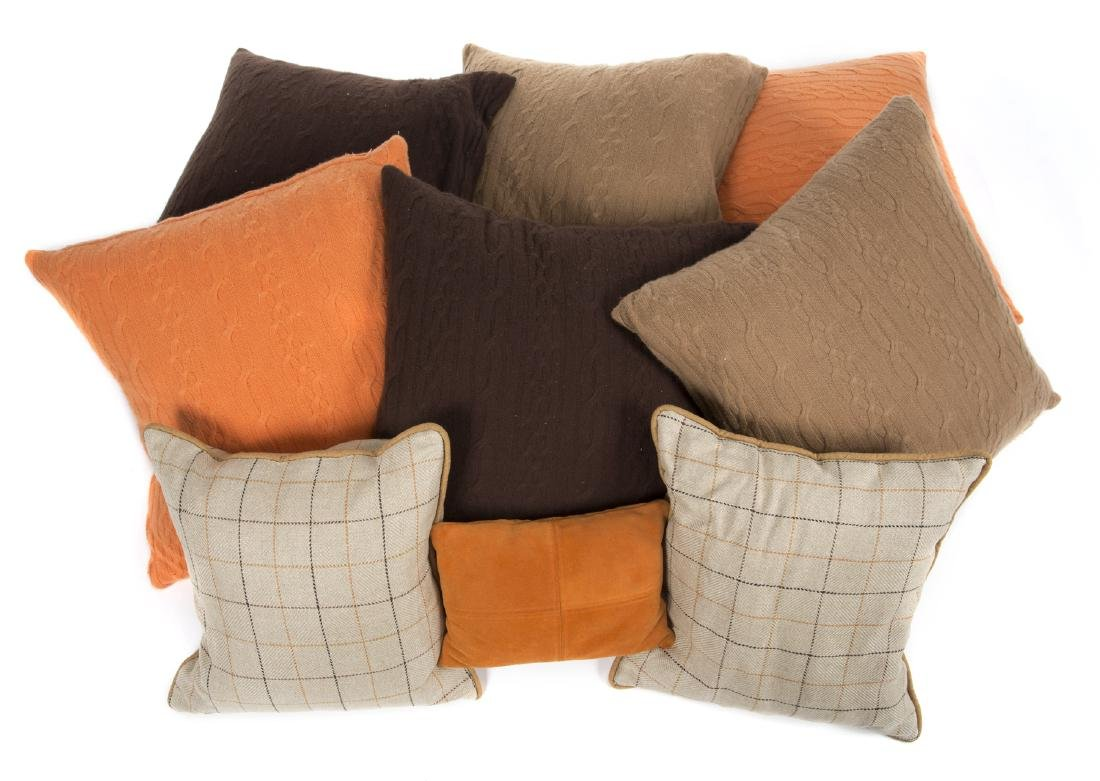 GROUP OF CASHMERE AND ORANGE PILLOWS