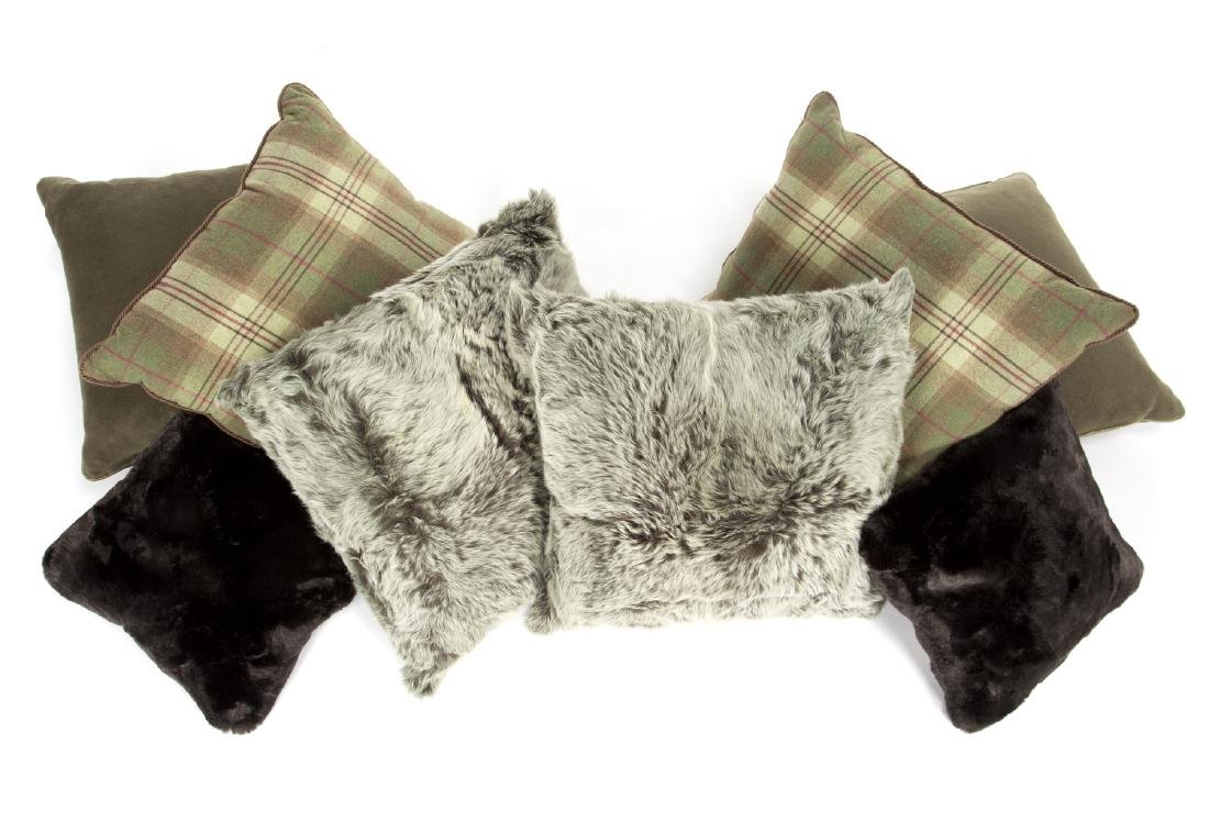 GROUP OF GREEN FUR AND PLAID PILLOWS