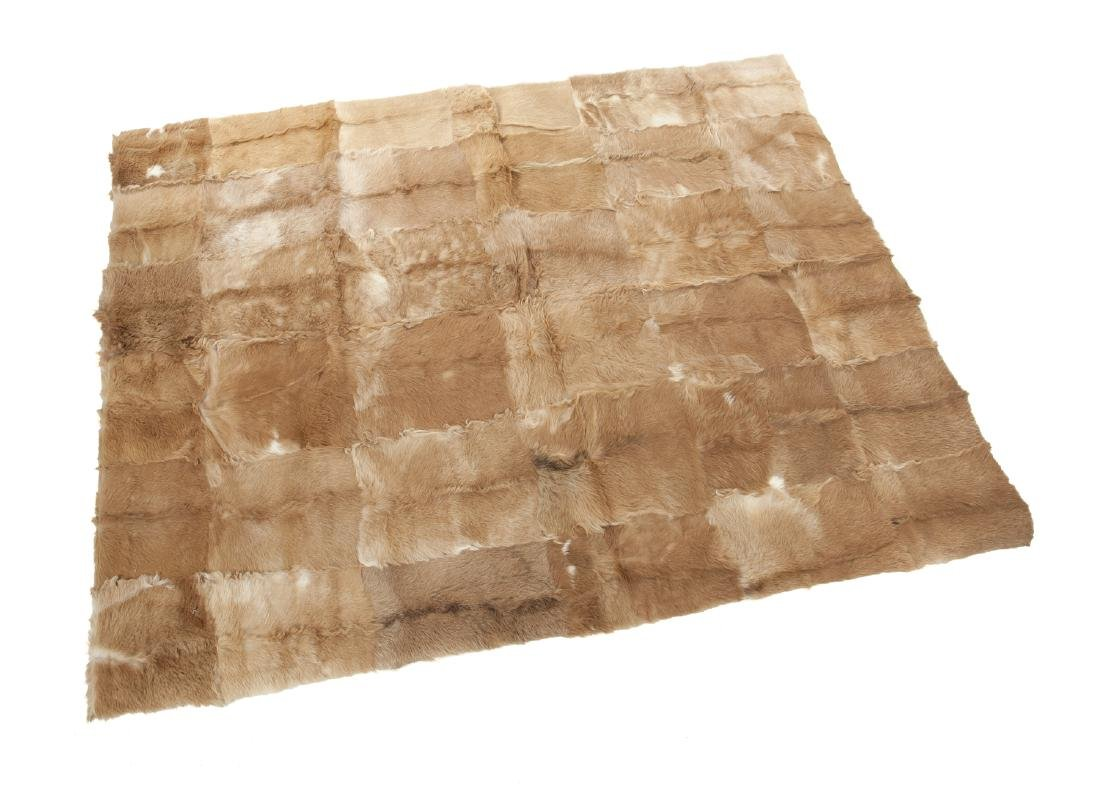 TWO PATCHWORK HIDE AREA RUGS