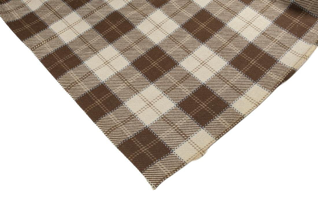 GROUP OF THREE BROWN AND CREAM PLAID RUGS