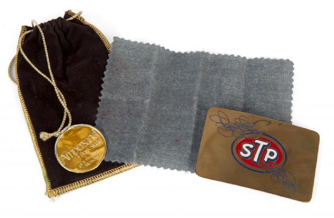 RICHARD PETTY AND KYLE PETTY ENGRAVED STP BELT BUCKLE