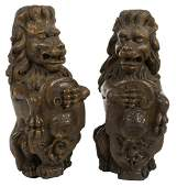 ROBERT EVANS PAIR OF CARVED OAK ENTRY LIONS ON