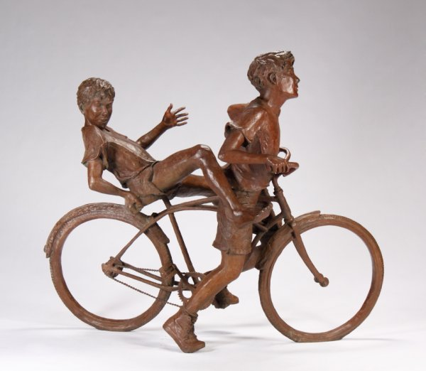 6: LIFE-SIZE SCULPTURE OF TWO BOYS ON A BICYCLE