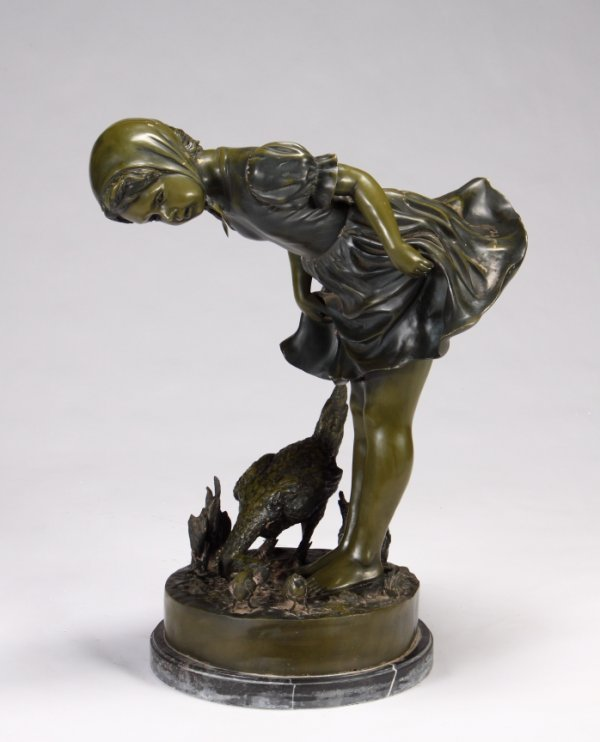 11: PATINATED METAL STATUE OF A GIRL WITH CHICKENS