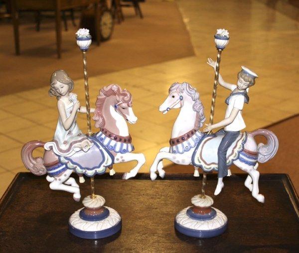 340: PAIR OF LLADRO FIGURINES - CHILDREN RIDING CAROUSE