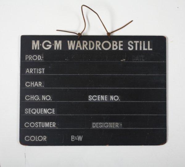 439: MGM COSTUME CLAPBOARD
