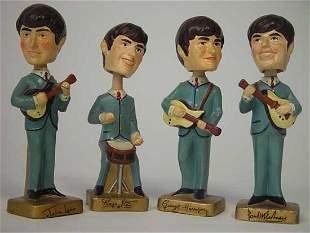 Four Vintage Beatles Bobbing Head Figurines