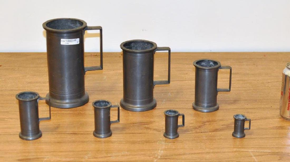 Group Seven Pewter Measures