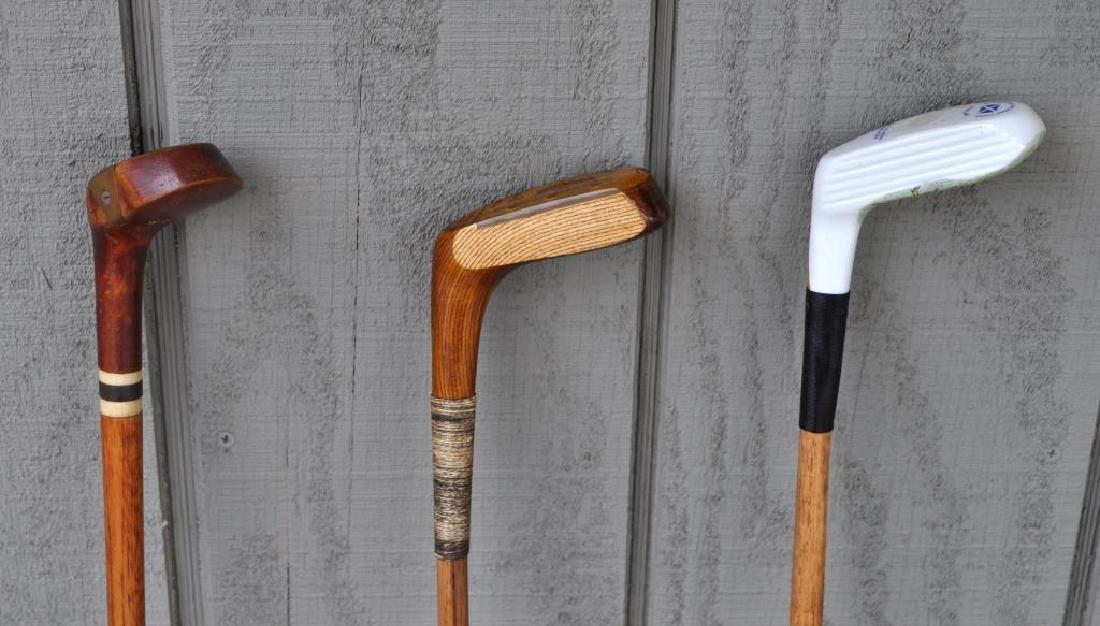 Three Vintage Golf Clubs