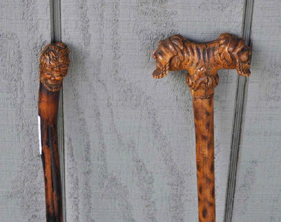Two Carved Wood Figural Canes