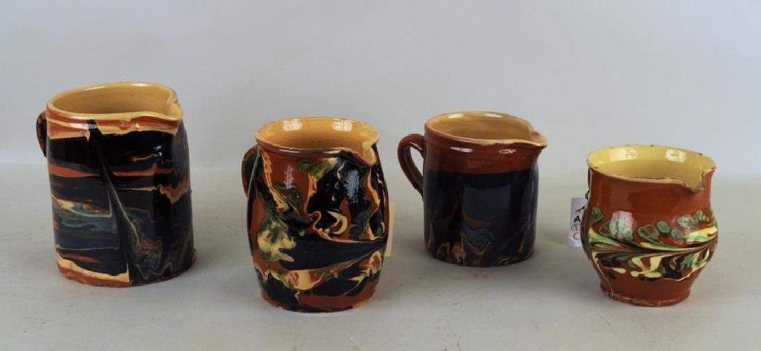 Group Four French Jaspe Slip Decorated Pitchers
