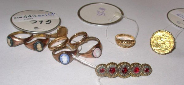 23: Group of Nine Gold Rings and a Bar Pin