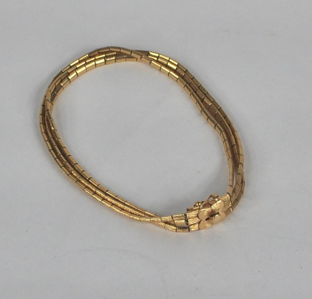9: 18K Gold Three Strand Bracelet