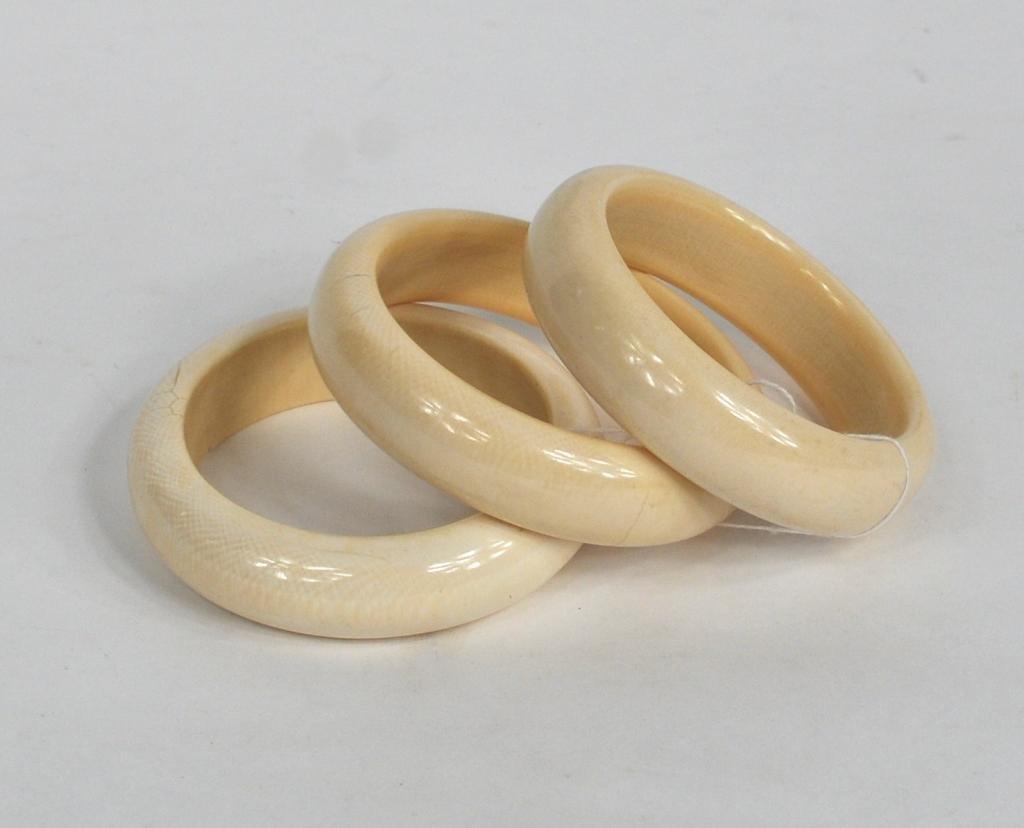 31: Three Ivory Smooth Bangle Bracelets