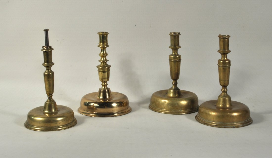 Group Four Continental Brass Candlesticks, 18th C.
