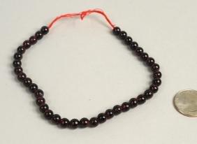Strand Of Round Garnet Beads