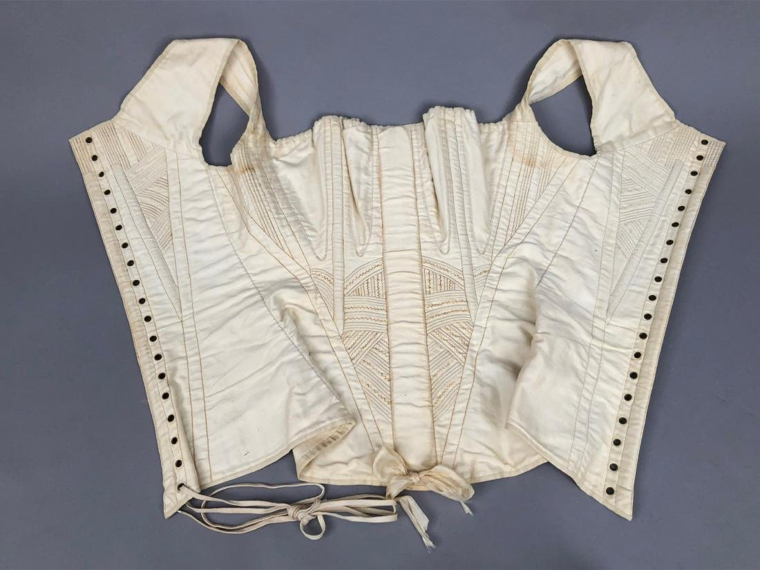 TWO WHITE COTTON CORSETS, 1825 - 1835