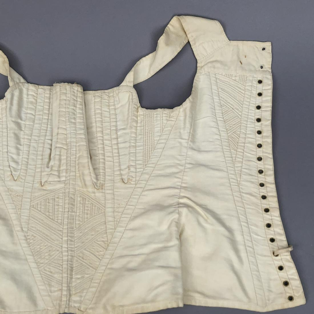 TWO WHITE COTTON CORSETS, 1825 - 1835 - 8