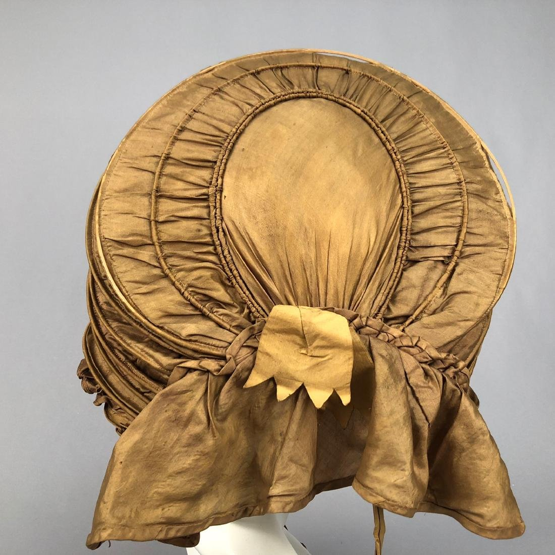 TWO COLLAPSIBLE SILK CALASH BONNETS, 1830s - 2