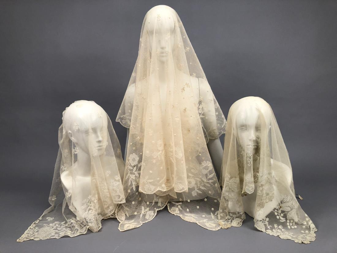 FOUR CREAM EMBROIDERED NET BONNET VEILS, 1810 - 1830