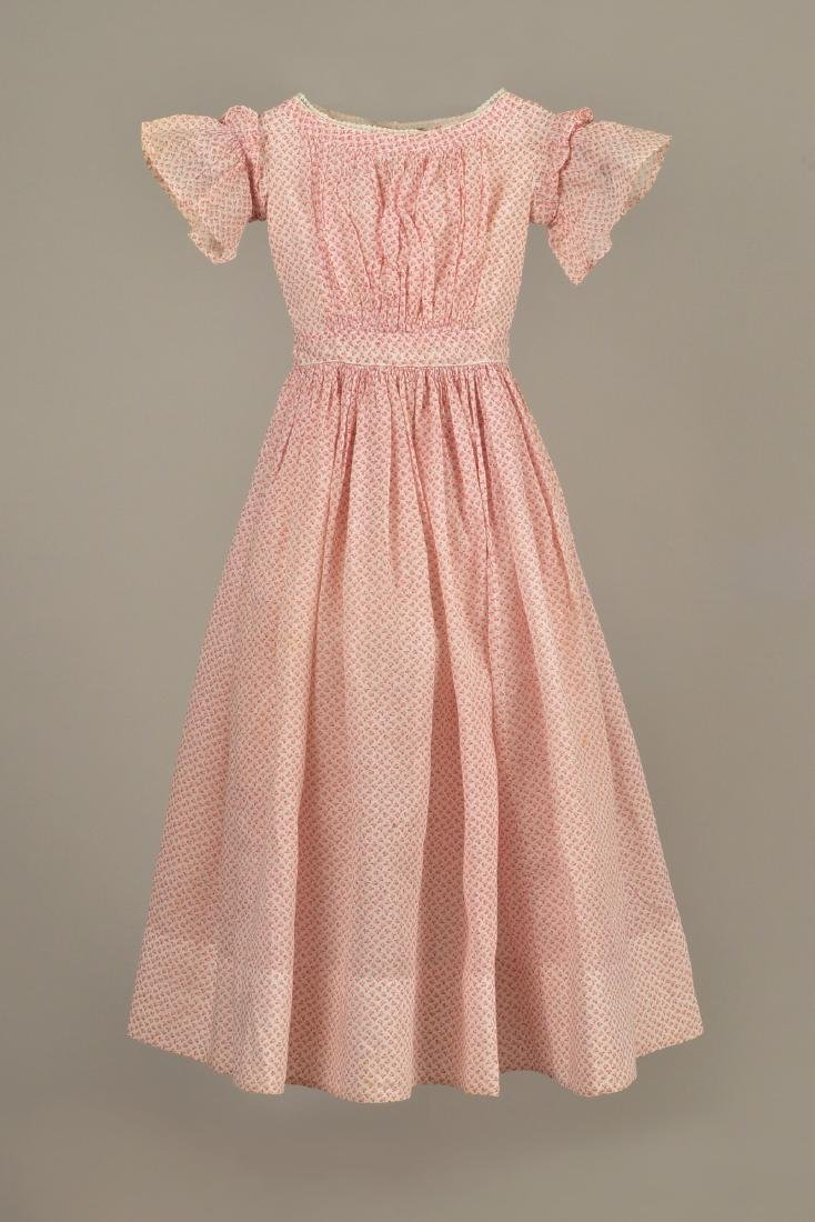 YOUNG GIRL'S PRINTED COTTON DRESS, c. 1845