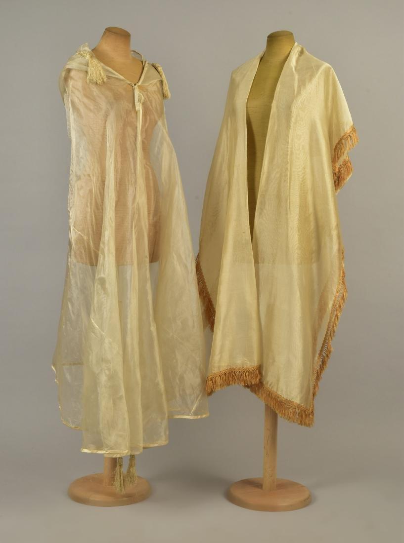 TWO CREAM SILK GAUZE BURNOOSES, 1860s